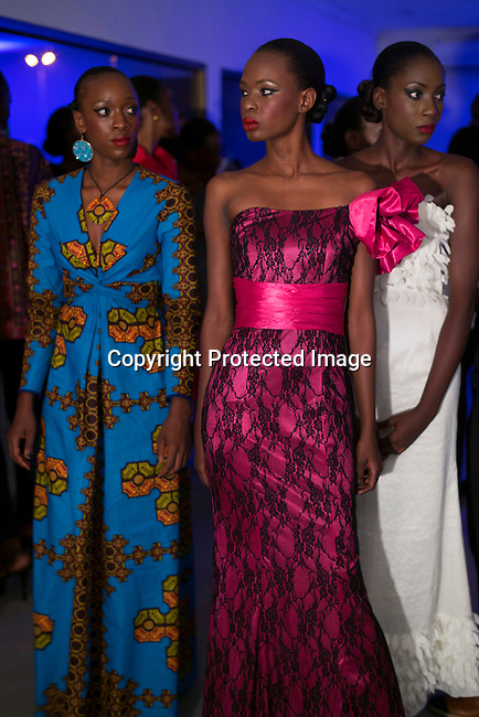 KINSHASA, DRC - JULY 25: Fashion models walking for the designer Okasola wait backstage before a show at Kinshasa Fashion Week on July 25, 2015, at Shark club in Kinshasa, DRC. Local and invited foreign-based designers showed their collections during the second edition of Kinshasa Fashion week. Photo by Per-Anders Pettersson)