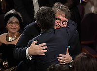 Guillermo del Toro celebrates winning the Oscar&reg; for achievement in directing for work on &ldquo;The Shape of Water&rdquo; during the live ABC Telecast of The 90th Oscars&reg; at the Dolby&reg; Theatre in Hollywood, CA on Sunday, March 4, 2018.<br /> *Editorial Use Only*<br /> CAP/PLF/AMPAS<br /> Supplied by Capital Pictures