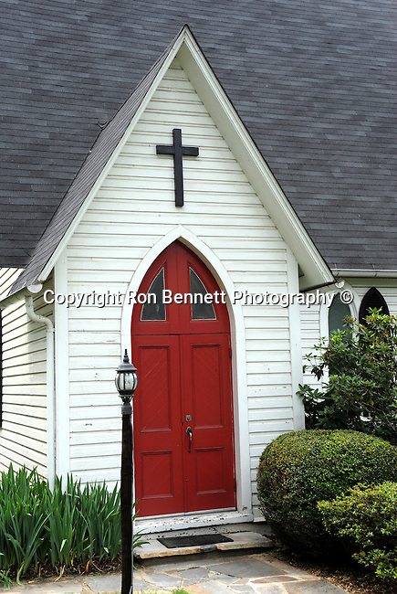 White church with cross over red door Aldie Virginia,