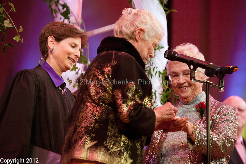 Jane Lighty and Pete-e Petersen, facing camera, get married by Judge Anne Levinson (ret.) at Benaroya Hall during intermission of the Seattle Mens' Chorus on December 9, 2012. Jane Lighty and Pete-e Petersen are considered the matriarchs of the Washington same-sex-marriage movement and have been together for 35 years.