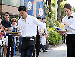 """May 22, 2016, Tokyo, Japan - Japanese waiter Daisuke Sonoda (L) carries a glass of beer on a tray en route to win the """"garcon carry race"""" in Tokyo on Sunday, May 22, 2016 as a  part of """"Aperitif 365"""" event. 46 waiters from restaurants and cafes participated the beer carry race vying for the first prize of 300,000 yen, sponsored by French beer Kronenbourg.  (Photo by Yoshio Tsunoda/AFLO) LWX -ytd-"""