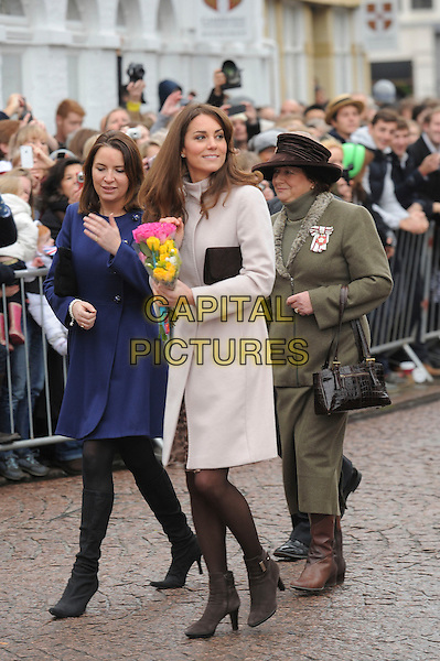 The Duke and Duchess of Cambridge visiting the city of Cambridge for the first time, Cambridge, England..November 28th, 2012.Prince William Kate Catherine Middleton royals royalty full length nude cream pink coat clutch  bag brown crowd tights brown ankle boots leopard print dress flowers bouquet .CAP/CAS.©Bob Cass/Capital Pictures.