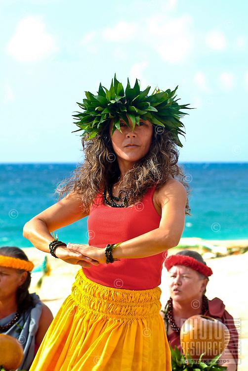 Local woman performing hula accompanied by oli (chant) and ipu (gourds) at a wedding on Ke'iki Beach, North Shore