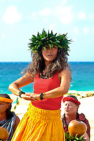 Local woman performing hula accompanied by oli (chant) and ipu (gourds) at a wedding on Ke'iki Beach, North Shore