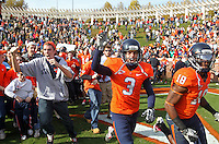 Oct 30, 2010; Charlottesville, VA, USA;   Virginia Cavaliers kicker Robert Randolph (3) and Virginia Cavaliers wide receiver Kris Burd (18) celebrates the 24-19 victory over the Miami Hurricanes at Scott Stadium. Mandatory Credit: Andrew Shurtleff