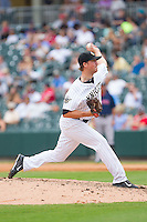 Charlotte Knights relief pitcher Charlie Leesman (11) in action against the Pawtucket Red Sox at BB&T Ballpark on August 8, 2014 in Charlotte, North Carolina.  The Red Sox defeated the Knights  11-8.  (Brian Westerholt/Four Seam Images)