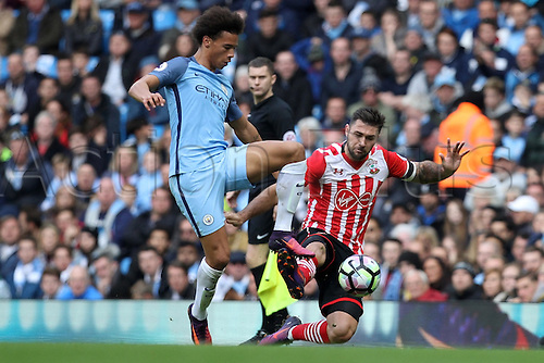 23.10.2016. The Etihad, Manchester, England. Premier League Football. Manchester City versus Southampton. Charlie Austin of Southampton clashes with Leroy Sane of Manchester City