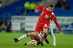International Friendly match between Wales and Scotland at the new Cardiff City Stadium : Wales' Joe Allen is tackeled by Stephen McManus of Scotland.