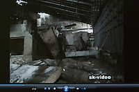 Part of a video shot inside 4th block of the Chernobyl power plant after the explosion - one of the most radioactive places on Earth. On the still picture - holes seen in sarcophagus walls through which daylight and air enters the main hall.