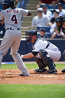 New York Yankees catcher Brian McCann (34) awaits the pitch as Cameron Maybin (9) bats during a Spring Training game against the Detroit Tigers on March 2, 2016 at George M. Steinbrenner Field in Tampa, Florida.  New York defeated Detroit 10-9.  (Mike Janes/Four Seam Images)
