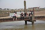 Women crabbing, Walberswick, Suffolk, England