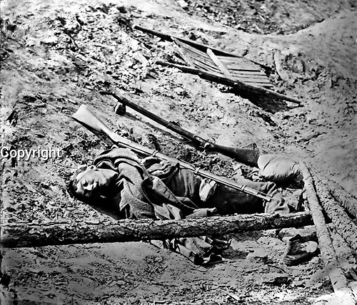 Dead Confederate Soldier in the Trenches.  This photograph was taken April (3), 1865, in the Rebel trenches at Petersburg just after their capture by Union troops.  Attributed to Thomas C. Roche.  Mathew Brady Collection. (Army)<br /> NARA FILE #: 111-B-65<br /> WAR & CONFLICT BOOK #:  256