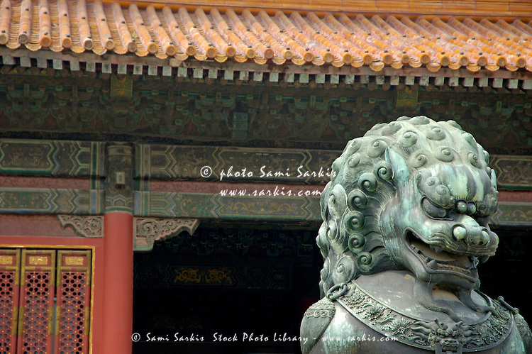 Bronze lion protecting the Gate of Supreme Harmony, Forbidden City, Beijing, China.