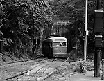 Pittsburgh PA:  View of the Knoxville Street Car (Trolley) emerging from the Mount Washington Tunnel into the South Hills Junction - 1963.  In the early 1960s, Pittsburgh had the largest surviving streetcar system in the United States. The Pittsburgh Railways Company operated more than 600 PCC cars on 41 routes. In 1964 the system was acquired by the Port Authority of Allegheny County, which rapidly converted to buses. By the early 1970s, only a handful of streetcar routes remained, most of which used the Mt. Washington Tunnel just south of the Monongahela River to reach the South Hills area.