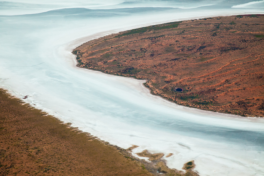 Aerial view of a Salt lake and Dunes over the Central australian desert.