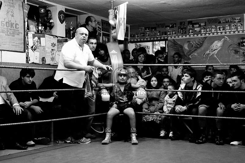 Boxer Vladimir Obrasov and coach Arik Drukman wait to start the boxing match for the Jerusalem Championship at the Jerusalem Boxing Club, November 20, 2009.  Located in a bomb shelter, the club has 150 members in which the big majority is Jewish, mostly emigrants from the former Soviet Union , with a minority of Palestinians from East Jerusalem (15 members). Lately the Palestinian boxers decided to open a club in East Jerusalem in order to recruit more Palestinian boxers.