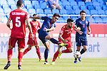 Teerasil Dangda of Thailand (L) competes for the ball with Komail Hasan Alaswad of Bahrain (R) during the AFC Asian Cup UAE 2019 Group A match between Bahrain (BHR) and Thailand (THA) at Al Maktoum Stadium on 10 January 2019 in Dubai, United Arab Emirates. Photo by Marcio Rodrigo Machado / Power Sport Images