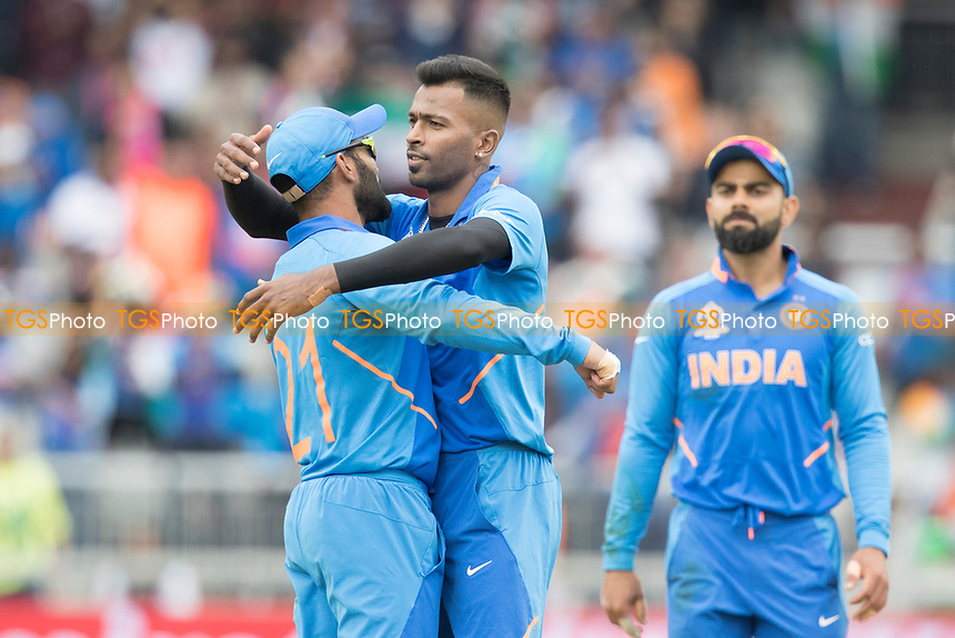 Dinesh Karthik (India) (who took the catch) congratulates Hardik Pandya (India) on the wicket of Neesham during India vs New Zealand, ICC World Cup Semi-Final Cricket at Old Trafford on 9th July 2019