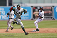 Fort Wayne TinCaps shortstop Fernando Tatis Jr. (23) makes a throw to first base against the West Michigan Michigan Whitecaps during the Midwest League baseball game on April 26, 2017 at Fifth Third Ballpark in Comstock Park, Michigan. West Michigan defeated Fort Wayne 8-2. (Andrew Woolley/Four Seam Images)