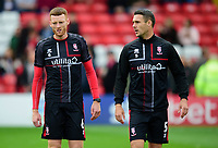 Lincoln City's Cian Bolger, left, and Jason Shackell during the pre-match warm-up<br /> <br /> Photographer Andrew Vaughan/CameraSport<br /> <br /> The EFL Sky Bet League One - Lincoln City v Sunderland - Saturday 5th October 2019 - Sincil Bank - Lincoln<br /> <br /> World Copyright © 2019 CameraSport. All rights reserved. 43 Linden Ave. Countesthorpe. Leicester. England. LE8 5PG - Tel: +44 (0) 116 277 4147 - admin@camerasport.com - www.camerasport.com