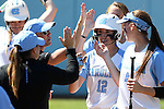 24 April 2016: North Carolina's Kristen Brown (12) is congratulated by teammates after scoring a run. The University of North Carolina Tar Heels hosted the University of Notre Dame Fighting Irish at Anderson Stadium in Chapel Hill, North Carolina in a 2016 NCAA Division I softball game. UNC won game 1 of the doubleheader 7-4.