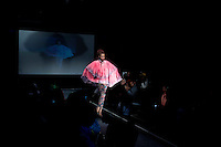 SOWETO, SOUTH AFRICA MAY 29: A model for the designer Avenue Floyd wears a garment during a fashion show at Soweto Fashion Week on May 29, 2014 at the Soweto Theatre in the Jabulani section of Soweto, South Africa. Local emerging designers showed their collections during the three-day event held at the theatre. Founded in 2012, Soweto fashion week gives a platform to local designers, models and artists. (Photo by: Per-Anders Pettersson)