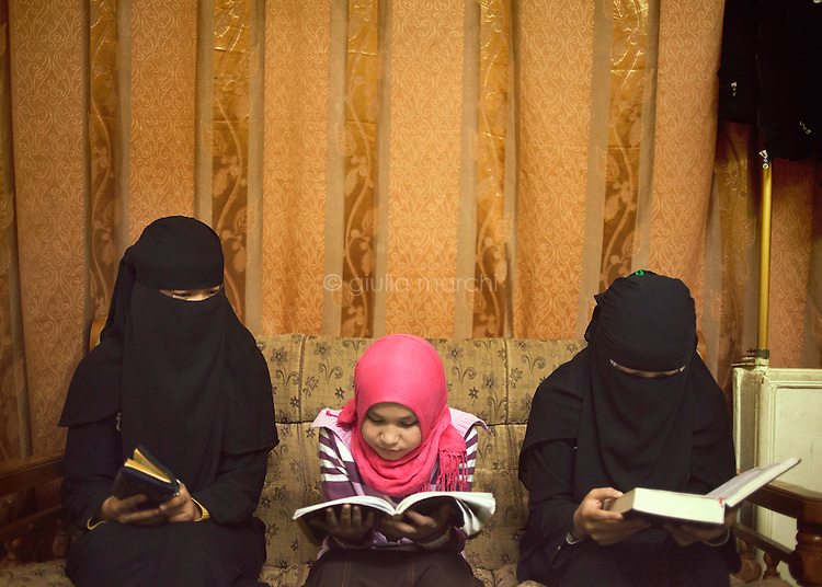 Egypt / Cairo / 16.2.2013 / Chinese girls read the Koran in a little Koranic school in Nasr City, neighbour area of Cairo where part of the Muslim Chinese community leaves, as well as many other people from Central Asia. © Giulia Marchi