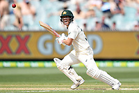 28th December 2019; Melbourne Cricket Ground, Melbourne, Victoria, Australia; International Test Cricket, Australia versus New Zealand, Test 2, Day 3; David Warner of Australia takes runs as he watches the ball through the covers - Editorial Use