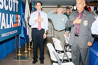 Republican presidential candidate and governor of Wisconsin Scott Walker says the Pledge of Allegiance before speaking at a meet and greet with veterans at the Derry VFW in Derry, New Hampshire.