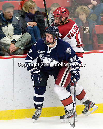 Jay Camper (UNH - 17), Alex Fallstrom (Harvard - 16) - The Harvard University Crimson defeated the University of New Hampshire Wildcats 7-6 on Tuesday, November 22, 2011, at Bright Hockey Center in Cambridge, Massachusetts.