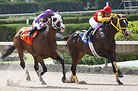 Fort Loudon(7) with Fernando Jara runs down Trinniberg (3) and wins the G3 Carry Back Stakes at Calder Race Course, Miami Gardens Florida. 07-07-2012.  Arron Haggart/Eclipse Sportswire.
