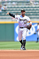Charlotte Knights second baseman Yoan Moncada (10) warms up before a game against the  Gwinnett Braves at BB&T Ballpark on May 7, 2017 in Charlotte, North Carolina. The Knights defeated the Braves 7-1. (Tony Farlow/Four Seam Images)