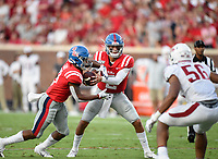 NWA Democrat-Gazette/CHARLIE KAIJO Ole Miss quarterback Matt Corral (2) hands the ball off to running back Jerrion Ealy (9) during the first quarter of a football game, Saturday, September 7, 2019 at Vaught-Hemingway Stadium in Oxford, Miss.