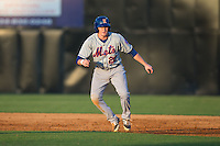 Ian Strom (20) of the Kingsport Mets takes his lead off of first base against the Danville Braves at American Legion Post 325 Field on July 9, 2016 in Danville, Virginia.  The Mets defeated the Braves 10-8.  (Brian Westerholt/Four Seam Images)