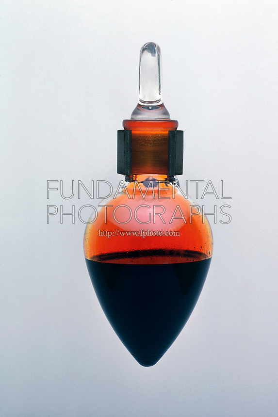 FLASK OF LIQUID BROMINE<br /> Bromine in Pear Shaped Flask<br /> Liquid Bromine evaporates at room temperature, giving off bromine gas. It is slightly transparent and somewhat dense as a liquid.
