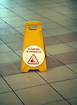 Plastic bollard notice on floor area that cleaning is in progress