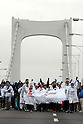 Table tennis player Ai Fukuhara, left, and other athletes join in a promotional event for the 2016 Tokyo Olympic bid, gRainbow Walkh held between Daiba and Tokyofs Rainbow Bridge on Sunday morning. Roughly 5,000 people walked across Tokyofs Rainbow Bridge the event. The participants, wearing scarves and gloves in the five Olympic colors, took a 7-kilometer walk amid occasional light rain on the 50-meter-high expressway bridge to Odaiba Park Tokyo Bay. 1 March, 2009. (Taro Fujimoto/JapanToday/Nippon News)