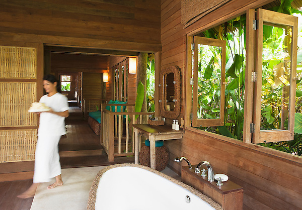 Traditional Thai House at The Spa, Six Senses Hideaway Yao Noi, Koh Yao Noi, Thailand. A traditional Thai Long House is used at The Spa for multi-step treatments. Guests start with a body scrub, followed by a massage, facial and floral bath--progressing from one end of the house to the other with each treatment.