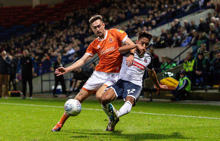 Bolton Wanderers' Adam Chicksen competing with Blackpool's Ryan Hardie (left) <br /> <br /> Photographer Andrew Kearns/CameraSport<br /> <br /> The EFL Sky Bet League One - Bolton Wanderers v Blackpool - Monday 7th October 2019 - University of Bolton Stadium - Bolton<br /> <br /> World Copyright © 2019 CameraSport. All rights reserved. 43 Linden Ave. Countesthorpe. Leicester. England. LE8 5PG - Tel: +44 (0) 116 277 4147 - admin@camerasport.com - www.camerasport.com
