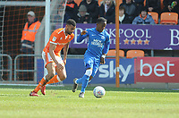 Peterborough United's Siriki Dembele under pressure from Blackpool's Curtis Tilt<br /> <br /> Photographer Kevin Barnes/CameraSport<br /> <br /> The EFL Sky Bet League One - Blackpool v Peterborough United - Saturday 13th April 2019 - Bloomfield Road - Blackpool<br /> <br /> World Copyright &copy; 2019 CameraSport. All rights reserved. 43 Linden Ave. Countesthorpe. Leicester. England. LE8 5PG - Tel: +44 (0) 116 277 4147 - admin@camerasport.com - www.camerasport.com