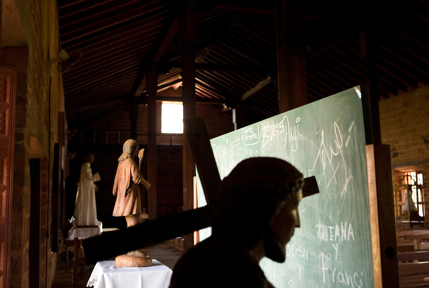 Inscriptions from local kids line a chalk board that stands among 18th-century statues in the Jesuit mission church at San Cosme y Damian, Paraguay. Scores of Jesuit missions in the area where Paraguay, Argentina and Brazil meet were built in the 17th century and abandoned when the Jesuits were expelled in the 18th century. Ruins of some of these missions still haunt hilltops in the region. The main church at San Cosme y Damian collapsed more than a century ago, but the community still uses the first provisional church built on the site. (Kevin Moloney for the New York Times)