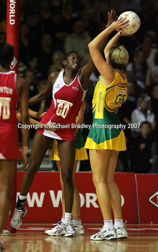 16.11.2007 Australian Catherine Cox and England's Sonia Mkoloma in action during the Australia v England match at the New World Netball World Champs held at Trusts Stadium Auckland New Zealand. Mandatory Photo Credit ©Michael Bradley.