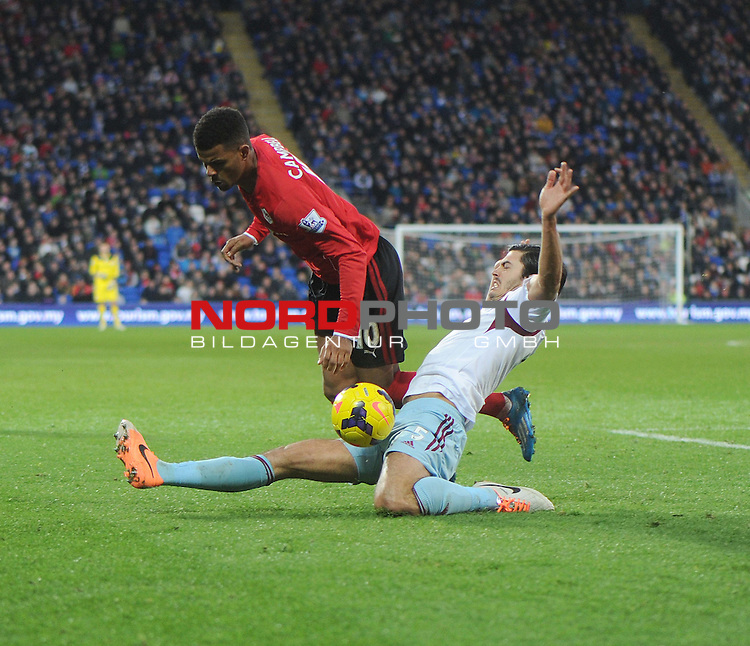 West Ham United&rsquo;s James Tomkins tackles Cardiff City's Fraizer Campbell -  11/01/2014 - SPORT - FOOTBALL - Cardiff City Stadium - Cardiff - Cardiff City v West Ham United - Barclays Premier League<br /> Foto nph / Meredith<br /> <br /> ***** OUT OF UK *****