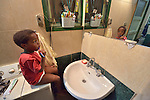 Ahmed Karim, a 4-year old refugee boy whose family comes from the Darfur region of Sudan, brushes his teeth as he gets ready for school in the family's crowded apartment in Cairo, Egypt. His parents have both taken adult education classes provided by St. Andrew's Refugee Services, which is supported by Church World Service.