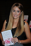 "LOS ANGELES, CA. - February 18: Lauren Conrad poses during the signing for her second book ""Sweet Little Lies"" at Barnes and Noble Booksellers at The Grove on February 18, 2010 in Los Angeles, California."