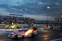 Jul. 19, 2013; Morrison, CO, USA: NHRA funny car driver Courtney Force (near) races alongside Johnny Gray during qualifying for the Mile High Nationals at Bandimere Speedway. Mandatory Credit: Mark J. Rebilas-