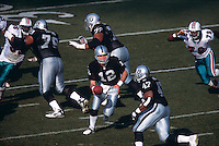 OAKLAND, CA - Quarterback Rich Gannon of the Oakland Raiders in action during a game against the Miami Dolphins at the Oakland Coliseum in Oakland, California in 2001. Photo by Brad Mangin