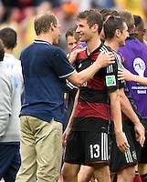 FUSSBALL WM 2014  VORRUNDE    GRUPPE G USA - Deutschland                  26.06.2014 Trainer Juergen Klinsmann (USA, li) scherzt nach dem Abpfiff mit Thomas Mueller (re, Deutschland)