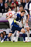 Osako Yuya of Japan (R) fights for the ball with Morteza Pouraliganji of Iran (L) during the AFC Asian Cup UAE 2019 Semi Finals match between I.R. Iran (IRN) and Japan (JPN) at Hazza Bin Zayed Stadium  on 28 January 2019 in Al Alin, United Arab Emirates. Photo by Marcio Rodrigo Machado / Power Sport Images