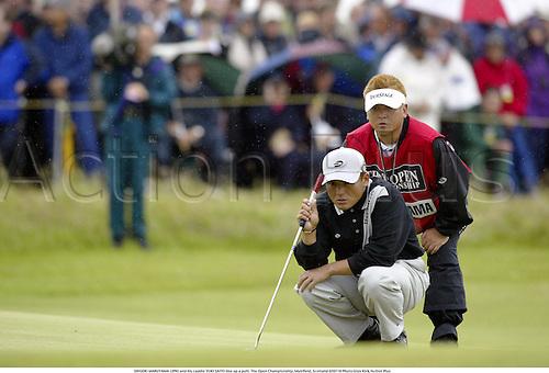 SHIGEKI MARUYAMA (JPN) and his caddie YUKI SAITO line up a putt. The Open Championship, Muirfield, Scotland 020719 Photo:Glyn Kirk/Action Plus...Golf golfer.2002 caddies.